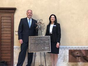 The Rucki Center for Hospice Care - Photo of Linda Ward and John Butler with dedication plaque.