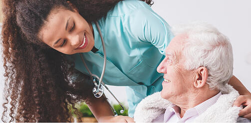 Female Home Health Nurse Smiling at Patient